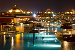 Hotel pool at night. Night scene of a beautifully lit hotel swimming pool in Egypt Stock Photo