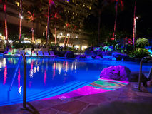 Hotel Pool at night with colorful lights Stock Image