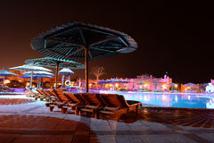 Hotel pool at night Royalty Free Stock Photos