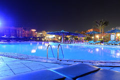 Hotel pool at night Stock Photo