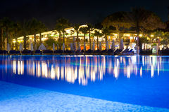 Hotel pool at night. Lights reflecting in water. Resort pool in Turkey Stock Photo