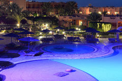 Hotel pool at night. A hotel swimming pool at night Royalty Free Stock Photography