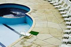 Hotel pool and patio. A view of a hotel pool and surrounding patio including lounge chairs Stock Image