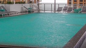 Hotel pool in rainy day. Hotel pool in Miami in rainy day stock video footage
