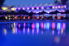 Hotel pool reflecting at night. Lights of hotel reflecting in pool at night Stock Photo
