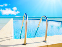 Hotel pool and sea all around Royalty Free Stock Images