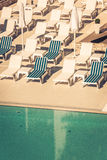 Hotel Poolside Chairs near a swimming pool Stock Photography