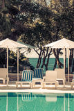 Hotel Poolside Chairs with Sea view Royalty Free Stock Photos