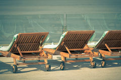 Hotel Poolside Chairs with Sea view Royalty Free Stock Photo