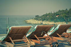 Hotel Poolside Chairs with Sea view Royalty Free Stock Images