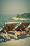 Hotel Poolside Chairs with Sea view. Royalty Free Stock Photography
