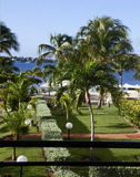 Hotel property facing lagoon on St.  Marten. A luxurious property of a hotel on the Caribbean island of St. Martin faces a large lagoon.  landscaping and lawn Stock Photo