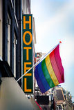 Hotel with The Rainbow Flag. Symbol of homosexual, bisexual, and transgender. Amsterdam, Netherlands royalty free stock photos