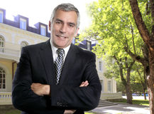 Hotel real estate business senior man suit outdoor royalty free stock photo