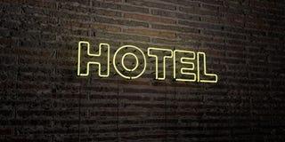 HOTEL - Realistisch Neonteken op Bakstenen muurachtergrond - 3D teruggegeven royalty vrij voorraadbeeld Stock Foto