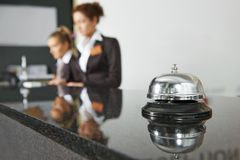 Hotel reception with bell. Modern luxury hotel reception counter desk with bell royalty free stock photography