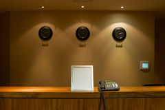 Hotel reception desk with phone and signboard Stock Photos