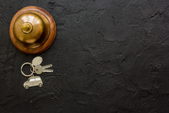 Hotel reception desk with ring and keys dark table background top view mockup Royalty Free Stock Photography