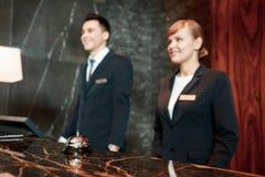 Hotel reception desk at work Stock Images