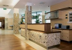 Hotel reception in marble and wood. In brown Royalty Free Stock Photos