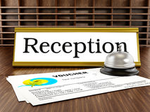 Hotel reception, service bell and voucher Stock Photo