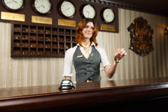 Hotel receptionist and counter desk with bell Stock Photography