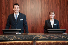 Hotel receptionists behind the counter Royalty Free Stock Photos