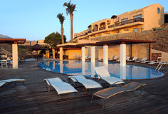 Hotel Recreation Area. With the swimming pool and pool chairs on Crete island in Greece at sunrise Stock Photos