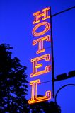 Hotel red light sign at dusk. Hotel red light sign in a blue sky at dusk stock photo