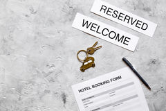 Hotel reservation blank and keys on stone background top view mockup Royalty Free Stock Photo
