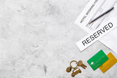 Hotel reservation blank and keys on stone background top view mockup Royalty Free Stock Photos