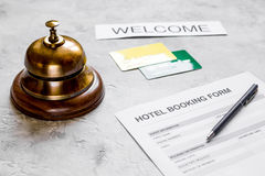 Hotel reservation blank and ring on stone background Royalty Free Stock Photography