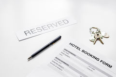 Hotel reservation blank and room keys on white background Royalty Free Stock Images
