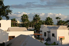 Hotel resort. Roofs of hotel buildings and palm trees Stock Images