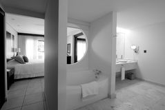 Hotel resort bathroom with jacuzzi. Black and white image of a hotel resort bathroom with jacuzzi Stock Photography