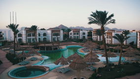 Hotel Resort with Blue Pool, Palm Trees and Sunbeds in Egypt stock video