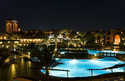 Hotel resort by night. Magnificent hotel with pool. A kind at night Royalty Free Stock Photo