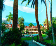 Hotel resort with pool. Beatiful hotel resort with pool and palms stock photography