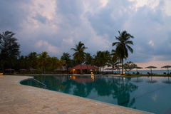 A Hotel or Resort Pool at Dusk Royalty Free Stock Images