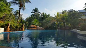 Hotel Resort Pool - Luxury Holiday. This clip is of a Tropical Hotel Resort Pool, perfect for any Luxury Holiday escape or tourism related video works stock video