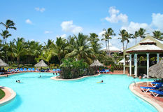 Hotel Resort Swimming Pool. Beach resort swimming pool on a summer day. Travel, Vacation & Hospitality Collection Royalty Free Stock Images