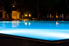 Hotel and resort swimming pool at night Stock Images