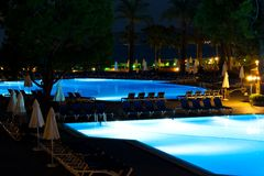 Hotel and resort swimming pool at night Stock Photography