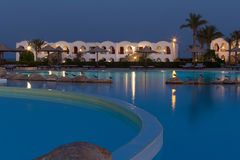 Hotel resort with swimming pool at night Stock Photography