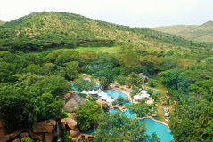 Hotel resort and swimming pool (South Africa). Landscape with green hills, luxury hotel resort and swimming pool (South Africa Royalty Free Stock Images
