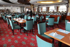 Hotel restaurant. Luxury hotel cafeteria interior with wood table and chairs Royalty Free Stock Photography