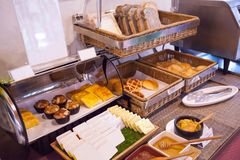 Hotel restaurant catering service healthy morning meal, American breakfast food buffet arrangement with Bakery Assortment in bambo royalty free stock images