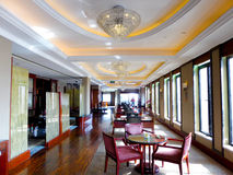 The hotel restaurant hall. A man standing inside a hotel restaurant hall Shanghai China Royalty Free Stock Image