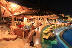 Hotel restaurant at night. Dusk at the poolside of a luxury hotel in Egypt Stock Image