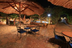 Hotel restaurant at night. Dusk at the poolside of a luxury hotel in Egypt Royalty Free Stock Image